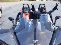 A snapshot of the Polaris Slingshot driven by a Batman and Batgirl costumed duo Saturday night near Oakland Beach.