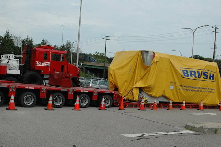 [CREDIT: Rob Borkowski] A 280-ton generator sits at the Rte. 117 park & ride while a safe route over RI bridges is planned.
