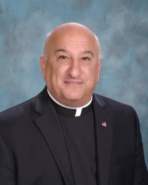 [CREDIT: Bishop Hendricken High School] Fr. Robert Marciano will lead Bishop Hendricken High School in 2019.
