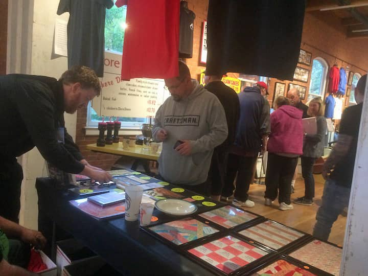 [CREDIT: Rob Borkowski] Volunteers helped sell Rocky Point merchandise during the opening reception.