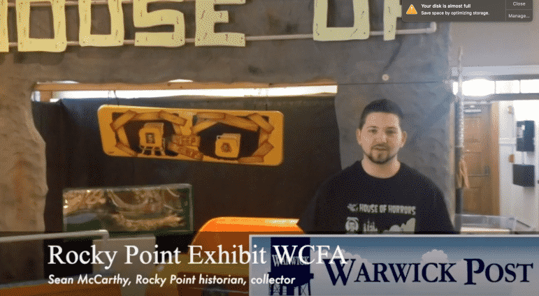 [CREDIT: Rob Borkowski] Sean McCarthy, Rocky Point collector and historian, shows off the Remembering Rocky Point! exhibit at the Warwick Center for the Arts.