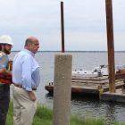 [CREDIT: Mayor Solomon's Offiice] Mayor Joseph Solomon observes the start of work to demolish the Rocky Point pier.
