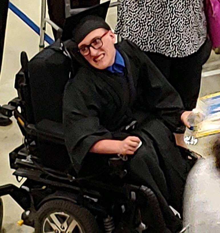 [CREDIT: Kim Wineman] Evan Huddon at CCRI following Pilgrim High School's 2019 graduation. Huddon does a toy drive every year at MeadowBrook bowling.