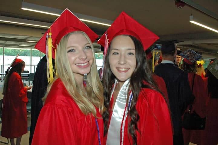 {CREDIT: Rob Borkowski] Brianna Jankowski and Madison Jackson on their way to graduation at CCRI June 6, 2019.