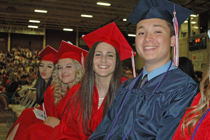 {CREDIT: Rob Borkowski] Front to back, Kyle Wright-Perry, Brittany Wysong, David Yabut, Rebecca Yaseen, and Jaquelin and Jennifer Zuniga wait during graduation at the CCRI field house June 6.