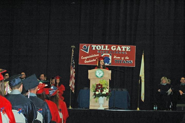 {CREDIT: Rob Borkowski] Toll Gate Class of 2019 Salutatorian Rebecca Carciieri addresses her classmates during graduation at the CCRI field house June 6.