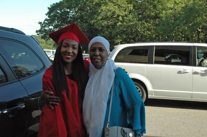 Anisah Syria Abdul-Rashid pauses outside CCRI with her mom, Amiwa, before graduation June 6.