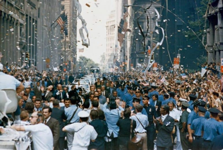 [CREDIT: NASA} New York City welcomes the Apollo 11 crew in a ticker tape parade down Broadway and Park Avenue. Pictured in the lead car, from the right, are astronauts Neil A. Armstrong, Michael Collins and Buzz Aldrin. The three astronauts teamed for the first manned lunar landing, on July 20, 1969.
